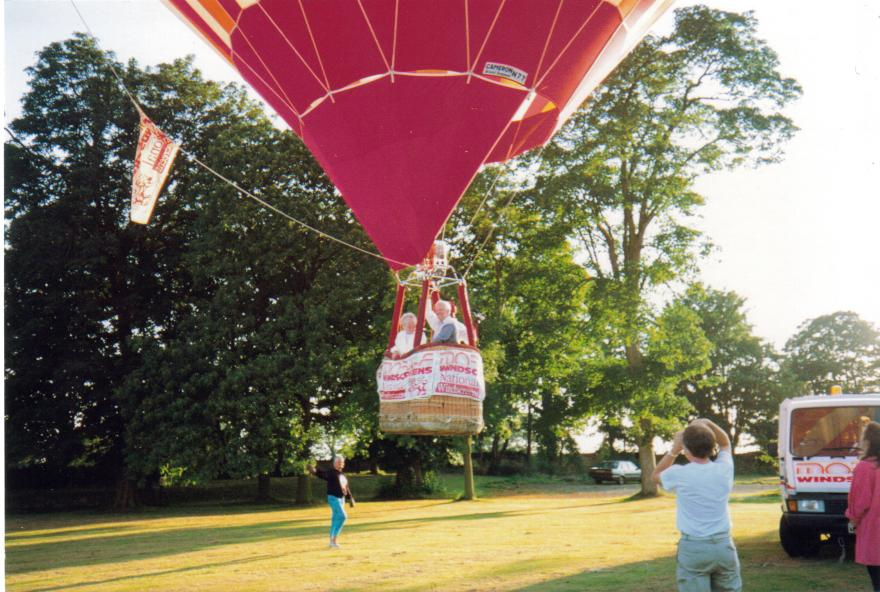 Balloon pilot John Kite flies his parents, George and Elma.