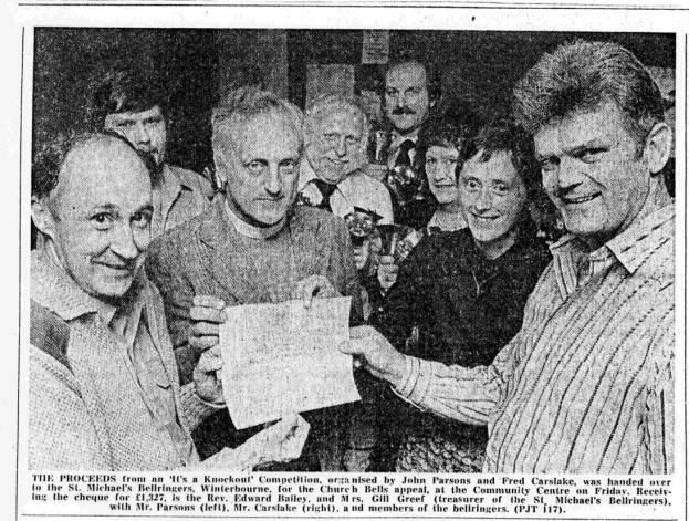 Fred hands over the cheque