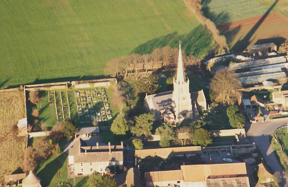 view of church, graveyard and Winterbourne Court from the air